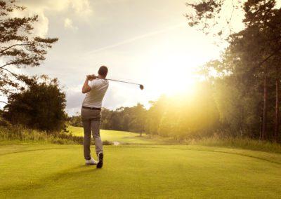Golf player at teeoff